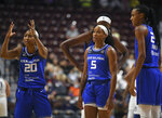 Connecticut Sun players including Briann January (20) Jasmine Thomas (5).react to a referee's call during the team's WNBA basketball game against the Minnesota Lynx on Tuesday, Aug. 17, 2021, in Uncasville, Conn. (Sarah Gordon/The Day via AP)