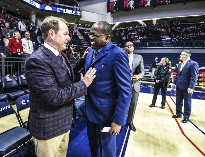 Mississippi head coach Kermit Davis, left, and Cal State Bakersfield head coach Rod Barnes talk before an NCAA college basketball game, Saturday, Dec, 7, 2019, in Oxford, Miss. (Bruce Newman/The Oxford Eagle via AP)