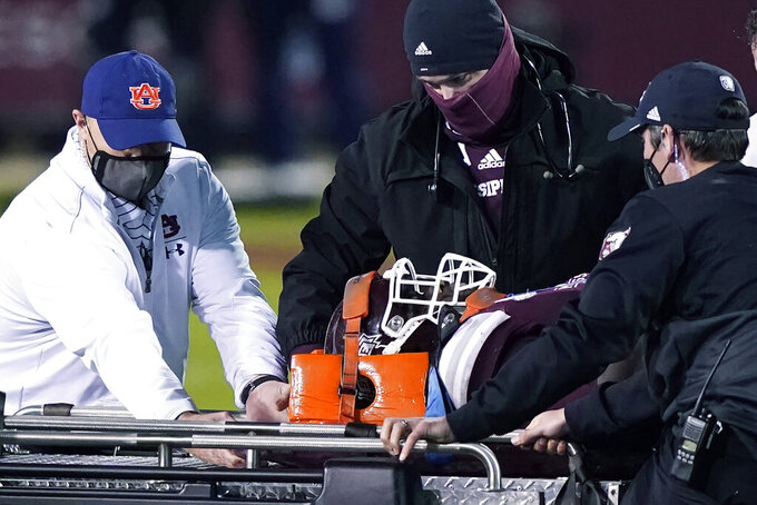 Medical personnel from both Mississippi State and Auburn tend to injured Mississippi State defensive end Marquiss Spencer in the second half of an NCAA college football game Saturday, Dec. 12, 2020, in Starkville, Miss. (AP Photo/Rogelio V. Solis)