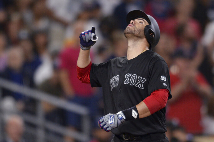 Boston Red Sox's J.D. Martinez looks skyward after hitting a three-run home run during the sixth inning of the team's baseball game against the San Diego Padres on Friday, Aug. 23, 2019, in San Diego. (AP Photo/Orlando Ramirez)