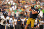 Notre Dame tight end Michael Mayer (87) makes a touchdown catch in front of Toledo linebacker Dyontae Johnson (2) in the second half of an NCAA college football game in South Bend, Ind., Saturday, Sept. 11, 2021. Notre Dame won 32-29. (AP Photo/AJ Mast)