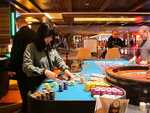 This April 17, 2015 photo shows a dealer handling stacks of gambling chips on a roulette table at the Tropicana Casino and Resort in Atlantic City, N.J. On June 16, 2020, the American Gaming Association, the casino industry's national trade group, called on state gambling regulators to make it easier for gamblers to use cashless betting options during the coronavirus outbreak. (AP Photo/Wayne Parry)
