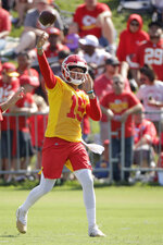 Kansas City Chiefs quarterback Patrick Mahomes throws during NFL football training camp Saturday, July 27, 2019, in St. Joseph, Mo. (AP Photo/Charlie Riedel)
