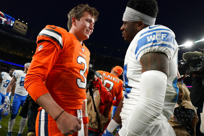 Denver Broncos quarterback Drew Lock (3) greets Detroit Lions cornerback Amani Oruwariye at mid field an NFL football game, Sunday, Dec. 22, 2019, in Denver. The Broncos won 27-17. (AP Photo/Jack Dempsey)