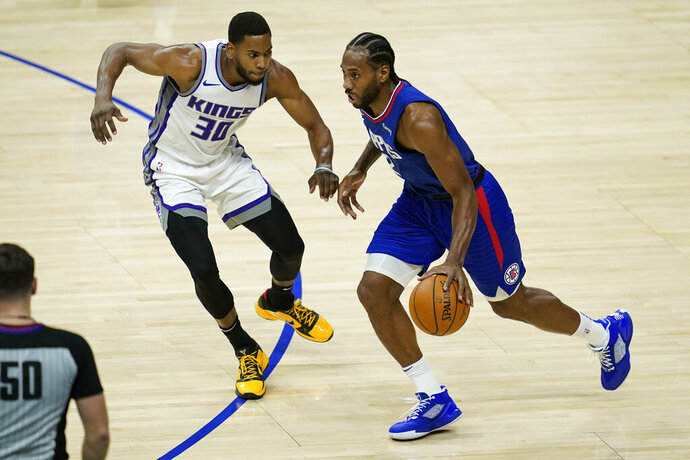 Sacramento Kings forward Glenn Robinson III (30) defends against Los Angeles Clippers forward Kawhi Leonard, right, during the first quarter of an NBA basketball game Wednesday, Jan. 20, 2021, in Los Angeles. (AP Photo/Ashley Landis)