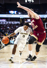 Wake Forest guard Brandon Childress (0) dribbles into defense from Boston College forward Nik Popovic (21) during an NCAA college basketball game, Saturday, Jan. 26, 2019 in Winston-Salem, N.C. (Andrew Dye/The Winston-Salem Journal via AP)