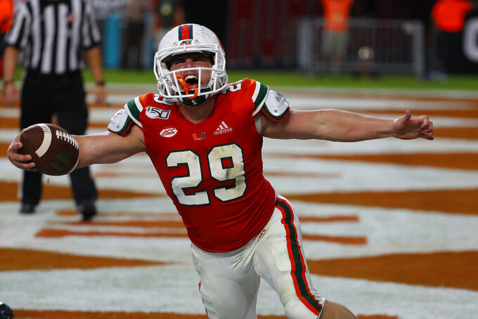 Miami defensive back Jimmy Murphy (29) celebrates after making a touchdown during the second half of an NCAA college football game against Bethune-Cookman, Saturday, Sept. 14, 2019, in Miami Gardens, Fla. (AP Photo/Wilfredo Lee)