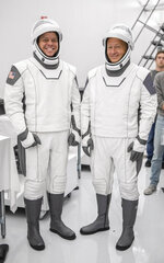 This July 31, 2019 photo made available by SpaceX shows astronauts Bob Behnken, left, and Doug Hurley in Hawthorne, Calif., during a joint training event between NASA and SpaceX. Following crew suit-up, the crew ingressed the capsule simulator in Hawthorne, Calif., as they would on launch day, and the teams performed a simulated launch countdown and several emergency egress scenarios. SpaceX designed and built its own suits, which are custom-fit. (SpaceX via AP)