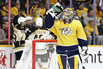 Nashville Predators goaltender Pekka Rinne (35), of Finland, takes a drink as Boston Bruins players celebrate a goal by right wing David Pastrnak (88), of the Czech Republic, in the first period of an NHL hockey game Tuesday, Jan. 7, 2020, in Nashville, Tenn. (AP Photo/Mark Humphrey)