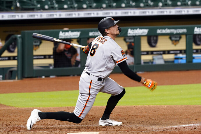 San Francisco Giants' Hunter Pence hits a three-run home run against the Houston Astros during the seventh inning of a baseball game Tuesday, Aug. 11, 2020, in Houston. (AP Photo/David J. Phillip)