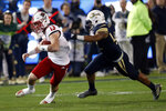 North Carolina State quarterback Devin Leary (13) tries to escape from Georgia Tech linebacker Jordan Domineck (42) during the first half of an NCAA college football game Thursday, Nov. 21, 2019, in Atlanta. (AP Photo/John Bazemore)