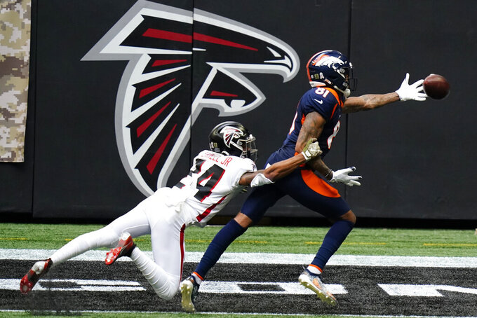 Denver Broncos wide receiver Tim Patrick (81) misses a ctach against Atlanta Falcons cornerback A.J. Terrell (24) during the first half of an NFL football game, Sunday, Nov. 8, 2020, in Atlanta. (AP Photo/Brynn Anderson)