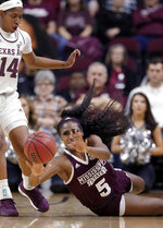 Mississippi State forward Anriel Howard (5) passes the ball as she falls in front of Texas A&M guard Jada Walton (14) during the second half of an NCAA college basketball game Sunday, Feb. 17, 2019, in College Station, Texas. (AP Photo/Michael Wyke)