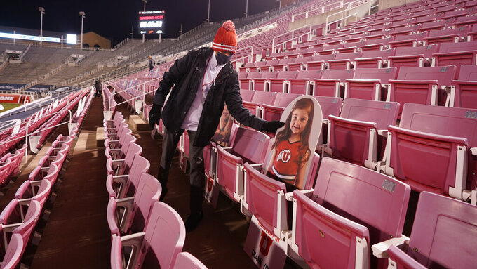 Cardboard cutouts are placed in the seats before an NCAA college football game between Oregon State and Utah, Saturday, Dec. 5, 2020, in Salt Lake City. (AP Photo/Rick Bowmer)