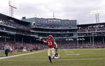 FILE - In this Nov. 17, 2018, file photo, Harvard wide receiver Jack Cook (83) raises the ball after crossing the goal line for a touchdown against Yale during the second half of an NCAA college football game at Fenway Park in Boston. The Ivy League has canceled all fall sports because of the coronavirus pandemic. (AP Photo/Charles Krupa, File)