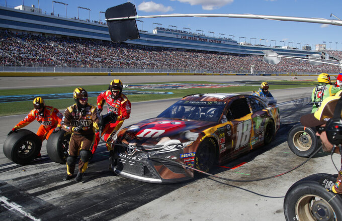 Kyle Busch makes a pit stop during a NASCAR Cup Series auto race at Las Vegas Motor Speedway, Sunday, March 3, 2019, in Las Vegas. (AP Photo/John Locher)