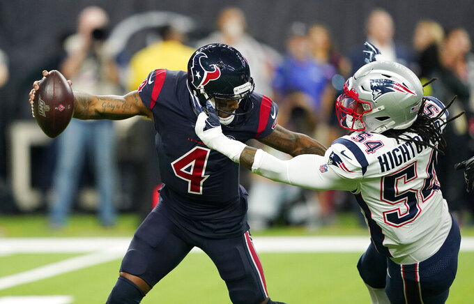 Houston Texans quarterback Deshaun Watson (4) is pressured by New England Patriots outside linebacker Dont'a Hightower (54) during the first half of an NFL football game Sunday, Dec. 1, 2019, in Houston. (AP Photo/David J. Phillip)
