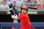 Los Angeles Angels' Shohei Ohtani, of Japan, watches the path of his foul ball against the Seattle Mariners in the second inning during a spring training baseball game Tuesday, March 10, 2020, in Peoria, Ariz. Ohtani struck out on the turn. (AP Photo/Elaine Thompson)