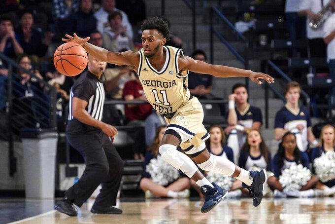 Georgia Tech guard Bubba Parham (11) reaches for the ball in the first half of an NCAA college basketball game against Arkansas Monday, Nov. 25, 2019, in Atlanta. (AP Photo/Danny Karnik)