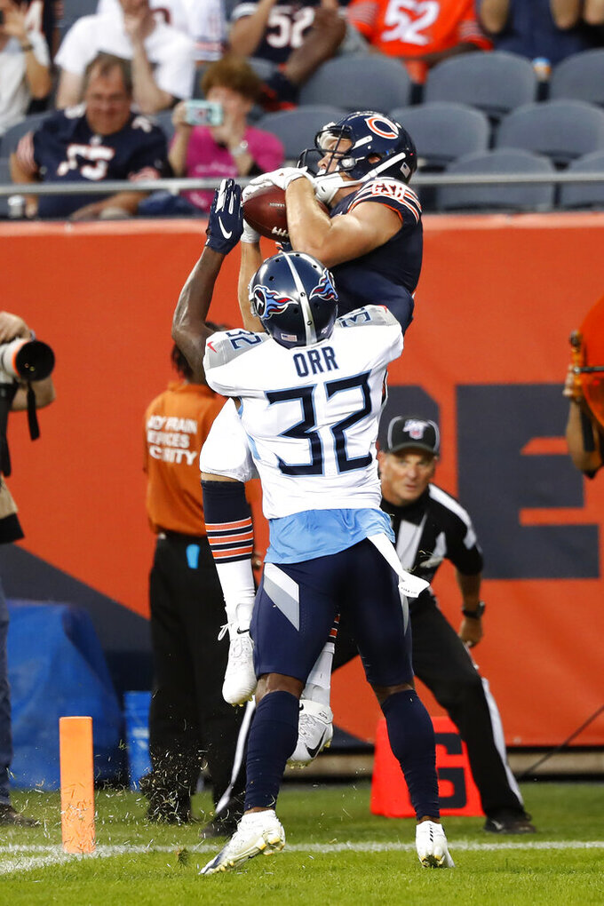 Chicago Bears tight end Jesper Horsted, top, makes a touchdown reception against Tennessee Titans defensive back Kareem Orr during the first half of an NFL preseason football game Thursday, Aug. 29, 2019, in Chicago. (AP Photo/Charles Rex Arbogast)