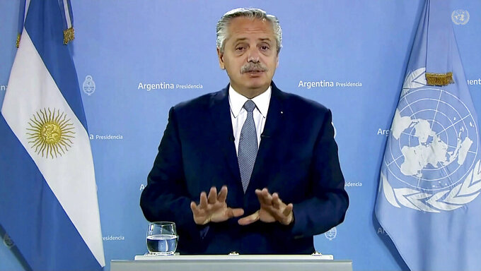 In this photo taken from video shown at United Nations headquarters, Argentina's President Alberto Fernández remotely addresses the 76th session of the U.N. General Assembly in a pre-recorded message, Tuesday Sept. 21, 2021 at UN headquarters. (UN Web TV via AP)