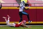 Carolina Panthers quarterback Teddy Bridgewater, top, scores a touchdown past Kansas City Chiefs free safety Daniel Sorensen during the second half of an NFL football game in Kansas City, Mo., Sunday, Nov. 8, 2020. (AP Photo/Orlin Wagner)