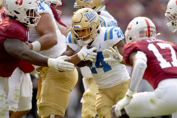 UCLA running back Zach Charbonnet (24) scores a touchdown past Stanford cornerback Kyu Blu Kelly (17) during the first half of an NCAA college football game Saturday, Sept. 25, 2021, in San Francisco, Calif. (AP Photo/Tony Avelar)