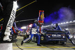 Chase Elliott makes a pit stop during a NASCAR Cup Series auto race at Charlotte Motor Speedway Thursday, May 28, 2020, in Concord, N.C. (AP Photo/Gerry Broome)