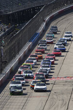 Justin Allgaier, left, and AJ Allmendinger, right, lead as cars are released from the first yellow flag of a NASCAR Xfinity Series auto race Saturday, Sept. 4, 2021, in Darlington, S.C. (AP Photo/John Amis)