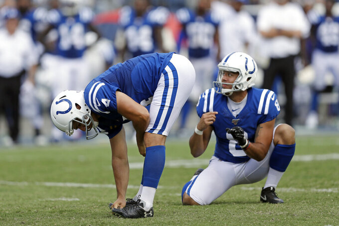 Indianapolis Colts kicker Adam Vinatieri (4) reacts to missing his second extra point of the game against the Tennessee Titans in the second half of an NFL football game Sunday, Sept. 15, 2019, in Nashville, Tenn. At right is holder Rigoberto Sanchez. (AP Photo/James Kenney)