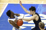 Kentucky's Terrence Clarke, left, has the ball knocked away by Notre Dame's Cormac Ryan during the second half of an NCAA college basketball game in Lexington, Ky., Saturday, Dec. 12, 2020. Notre Dame won 64-63. (AP Photo/James Crisp)