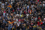 Independence protesters gather in Barcelona, Spain, Saturday, Oct. 19, 2019. Barcelona and the rest of the restive Spanish region of Catalonia are reeling from five straight days of violent protests for the sentencing of 12 separatist leaders to lengthy prison sentences.The riots have broken out at nightfall following huge peaceful protests each day since Monday's Supreme Court verdict. (AP Photo/Manu Fernandez)