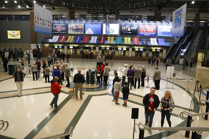 Fans arrive during the second half of an NCAA college basketball game between Northwestern and Minnesota at the Big Ten Conference tournament, Wednesday, March 11, 2020, in Indianapolis. Minnesota won 74-57. (AP Photo/Darron Cummings)