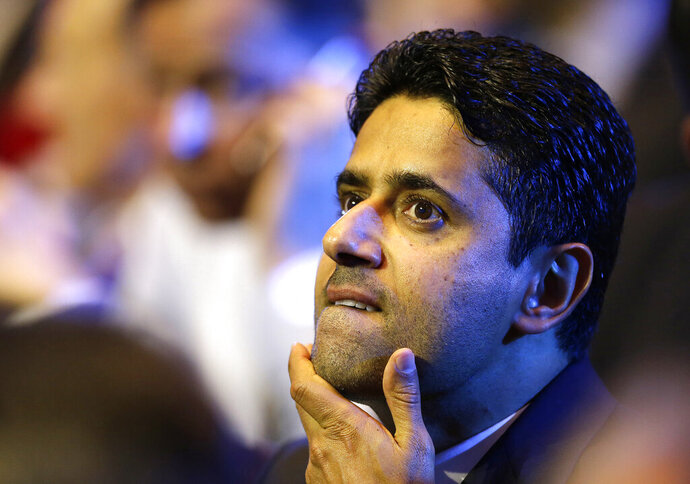 FILE - In this Aug. 25, 2016 file photo, President of Paris Saint-Germain soccer club, Nasser Al-Khelaifi, gestures during the UEFA Champions League draw at the Grimaldi Forum, in Monaco. A French judicial official says the president of Paris Saint-Germain has been placed under investigation for suspected corruption. (AP Photo/Claude Paris, File)