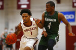 Colgate's Jordan Burns (1) drives past Loyola (Md.) Isaiah Hart ball during an NCAA college basketball game in the finals of the Patriot League tournament, Sunday, March 14, 2021, in Hamilton, N.Y. (AP Photo/John Munson)