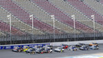 Pole sitter Chandler Smith (51) leads the field to the start of a NASCAR Truck Series auto race at Michigan International Speedway in Brooklyn, Mich., Friday, Aug. 7, 2020. (AP Photo/Paul Sancya)