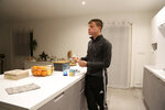 Evan Cesa, 18, eats his breakfast at his home near Nice, southern France, Monday, Feb. 8, 2021, with little appetite because he has lost his sense of smell and taste since he contracted COVID-19 in September 2020. A year into the coronavirus pandemic, doctors are striving to better understand and treat patients who lose their sense of smell. (AP Photo/John Leicester)