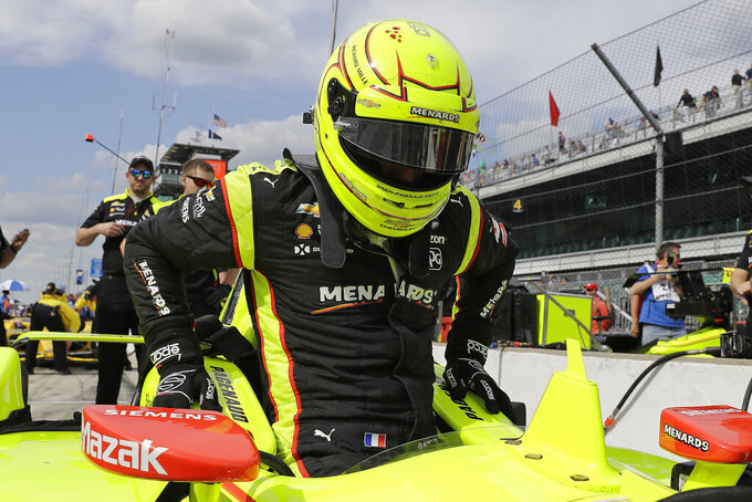 Simon Pagenaud, of France, climbs into his car during practice for the Indianapolis 500 IndyCar auto race at Indianapolis Motor Speedway, Tuesday, May 14, 2019 in Indianapolis. (AP Photo/Darron Cummings)