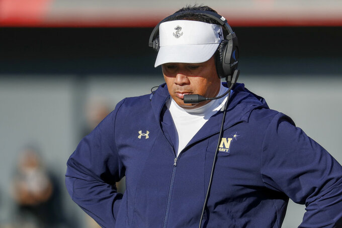 Navy head coach Ken Niumatalolo works the sidelines in the first half of an NCAA college football game against Cincinnati, Saturday, Nov. 3, 2018, in Cincinnati. (AP Photo/John Minchillo)