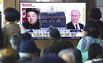 People watch a TV screen showing images of North Korean leader Kim Jong Un, left, and Russian President Vladimir Putin, right, during a news program at the Seoul Railway Station in Seoul, South Korea, Tuesday, April 23, 2019. North Korea confirmed Tuesday that Kim will soon visit Russia to meet with Putin in a summit that comes at a crucial moment for tenuous diplomacy meant to rid the North of its nuclear arsenal. The Korean letters on the screen read::