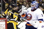Pittsburgh Penguins' Phil Kessel (81) celebrates his first of two second-period goals as New York Islanders goaltender Thomas Greiss (1) looks on during an NHL hockey game in Pittsburgh, Thursday, Dec. 6, 2018. (AP Photo/Gene J. Puskar)