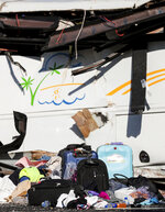 Luggage sits on the roadway at the scene where at least four people were killed in a tour bus crash near Bryce Canyon National Park, Friday, Sept. 20, 2019, in Utah. (Spenser Heaps/The Deseret News via AP)