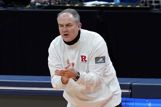 Rutgers head coach Steve Pikiell claps during the first half of a men's college basketball game against Clemson in the first round of the NCAA tournament at Bankers Life Fieldhouse in Indianapolis, Friday, March 19, 2021. (AP Photo/Paul Sancya)