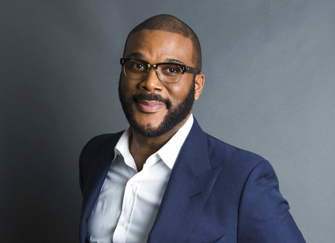 FILE - In this Nov. 16, 2017, file photo, actor-filmmaker and author Tyler Perry poses for a portrait in New York to promote his book,