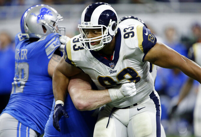 FILE - In this Dec. 2, 2018, file photo, Los Angeles Rams nose tackle Ndamukong Suh (93) rushes during the second half of an NFL football game against the Detroit Lions in Detroit. The Rams know they've got to pressure Tom Brady early and often to have a chance in the Super Bowl, and they've been assembling the tools for this job all year long. They signed Ndamukong Suh to a big free-agent deal, wrote a record-breaking contract for Aaron Donald and acquired edge rusher Dante Fowler from Jacksonville down the stretch. (AP Photo/Duane Burleson, File)