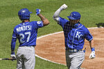 Kansas City Royals' Alex Gordon, right, celebrates with Adalberto Mondesi after hitting a solo home run against the Chicago White Sox during the second inning of a baseball game in Chicago, Saturday, Aug. 29, 2020. (AP Photo/Nam Y. Huh)