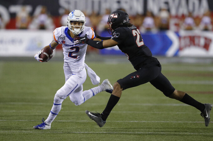 Boise State Broncos wide receiver Khalil Shakir runs after making a catch against UNLV Rebels defensive back Greg Francis during the first half of an NCAA college football game Saturday, Oct. 5, 2019, in Las Vegas. (AP Photo/John Locher)
