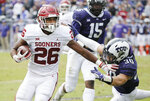FILE - In this Saturday, Oct. 20, 2018, file photo, Oklahoma running back Kennedy Brooks (26) battles past TCU linebacker Garret Wallow (30) to score a touchdown during the first half of an NCAA college football game, in Fort Worth, Texas. This season, four Big 12 backs are averaging at least 100 yards rushing per game in conference action. (AP Photo/Brandon Wade, File)