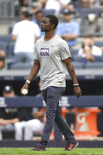 HOPE Week honoree Chris Singleton walks to the mound to throw a ceremonial first pitch prior to a baseball game between the New York Yankees and the Tampa Bay Rays, Monday, June 17, 2019, in New York. (AP Photo/Sarah Stier)
