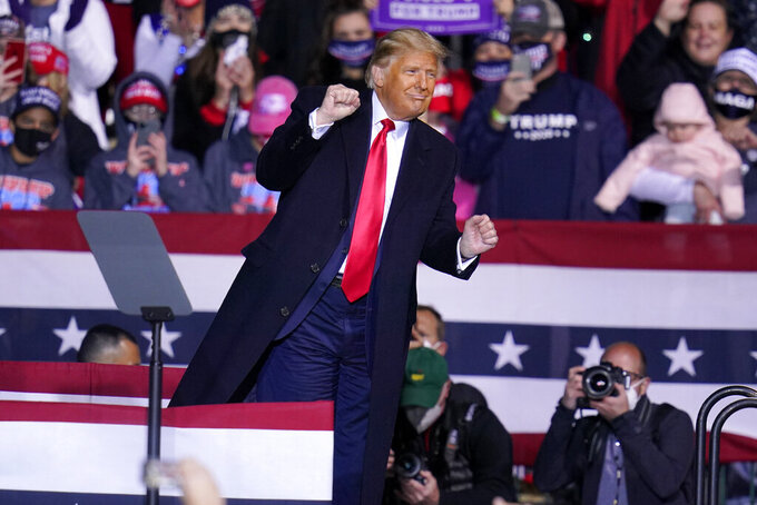 President Donald Trump moves to the song YMCA as he finishes a campaign rally at John P. Murtha Johnstown-Cambria County Airport in Johnstown, Pa., Tuesday, Oct. 13, 2020. (AP Photo/Gene J. Puskar)